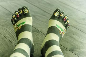 Female feet in japanese socks.