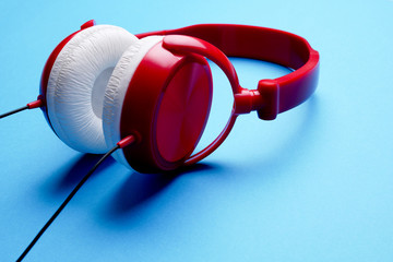Photo of red with white headphones close-up