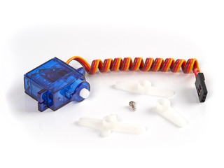 Small blue servo-unit for RC modeling isolated on white background with a set of three plastic arms.
