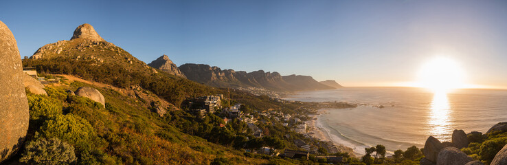 View of Lions Head and the Twelve Apostles at sunset in Cape Town