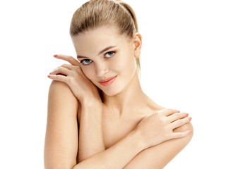 Beautiful lady with arms crossed over her chest. Photo of young girl  with smooth and healthy skin on white background. Youth and skin care concept