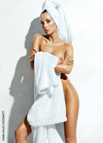 Beautiful woman in white bathrobe after spa. Photo of well-groomed woman on  white 0cf09d933