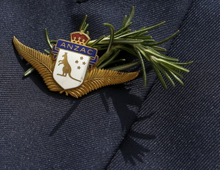 Man wears a period ANZAC badge and rosemary sprig during a service to mark the 100th anniversary of ANZAC landings at Gallipoli, at the Pieta Military Cemetery in Pieta, Malta
