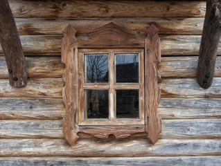 Window of the old rural house in a wooden frame