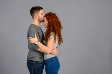 Nice young couple in the studio