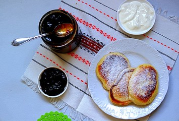 Pancakes with corn flour. Served with berry jam and sour cream