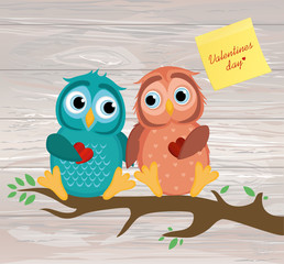 A pair of cute owlet sitting on a branch. Yellow sheet of paper
