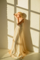Bride in her wedding dress dancing
