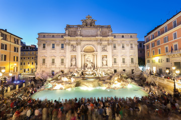 Rome Trevi Fountain or Fontana di Trevi at dusk, Rome, Italy. Trevi is the largest Baroque, most famous and visited by tourists fountain of Rome.