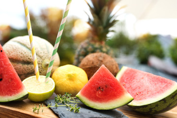 Exotic summer fruits on a wooden table