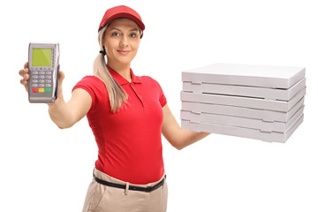 Delivery girl holding a payment terminal and a stack of pizza boxes