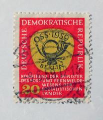 Leeds, England - April 18 2018: An old red east german postage stamp with postal horn design