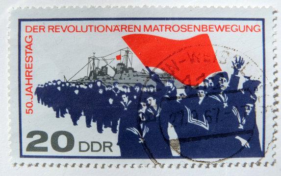 Leeds, England - April 18 2018: An old east german postage stamp celebrating the german naval revolt of 1917