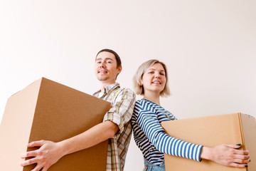 Photo of young man and woman with cardboard box