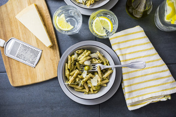 Pasta with green pesto and olives