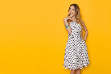 Beautiful Young Woman In Summer Dress Is Looking Away And Talking