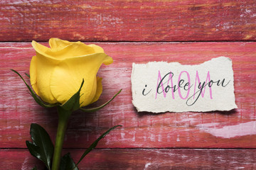 yellow rose and text I love you mom in a note