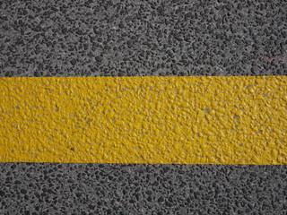 Textur Asphalt und gelber Streifen