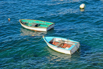 old fishing boats in the turquoise sea