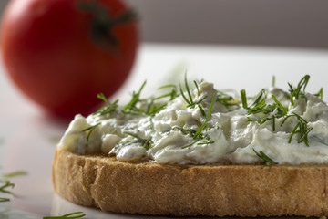 Open sandwich with toast and homande cheese cream with fresh dill