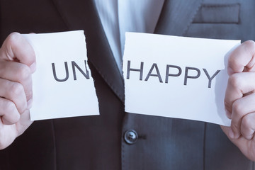 Happy concept. Man hand holding card with text uphappy, tore off word un