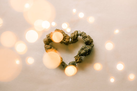 Cannabis Weed Marijauna in Heart Shape with Fairy Lights