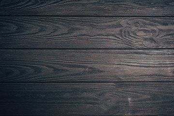 texture of black wood use as natural background, gloomy wooden table