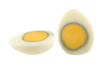 boiled egg peeled sliced on white background