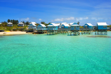 Beautiful tropical beach on Bermuda Island and houses on stilts