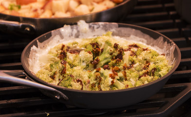 Broccoli with soy sauce and a cream sauce in a frying pan