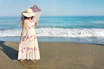 Woman Straw hat Umbrella Beach