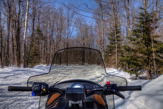 Snowmobiling through the Woods of Northern Minnesota in Winter