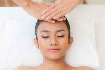 Beautiful woman having a facial massage , portrait of young beautiful woman in spa environment