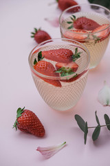 Soda with strawberries on a pink background. Summer refreshing drink. Top view