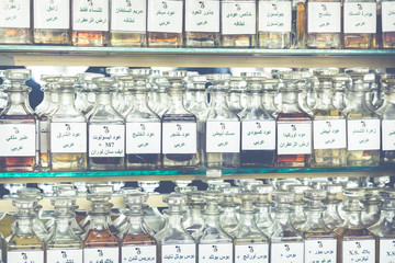 many different perfums in a store on the market