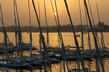 Sunset at River Nile with the boats in Luxor, Egypt