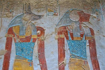 Painting of Egyptian god of Anubis and another god in the Valley of Kings in Luxor, Egypt