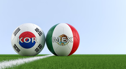 Mexico vs. South Korea Soccer Match - Soccer balls iMexicos and South Korean national colors on a soccer field. Copy space on the right side - 3D Rendering