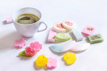 Japanese sweets and matcha tea Cup on white background