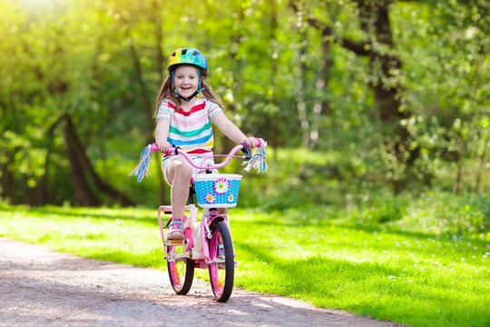 Child on bike. Kids ride bicycle. Girl cycling.