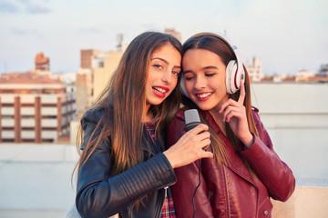 Best friends band girls singing karaoke outdoor