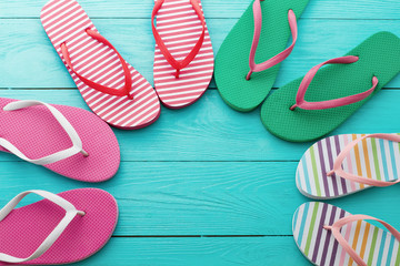 flip flops on blue wooden floor background. Top view and copy space. Summer fun holidays. Beach Sandals