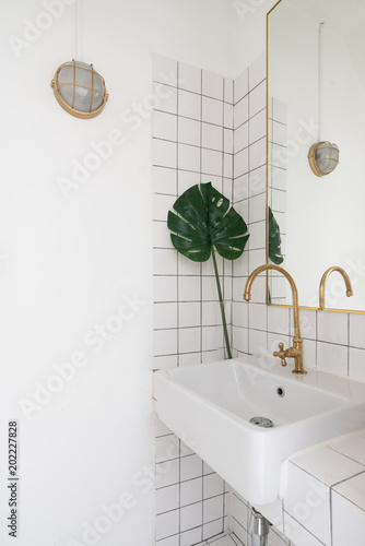 Cozy Wash Basin Corner With White Tile And Gray Grout On The