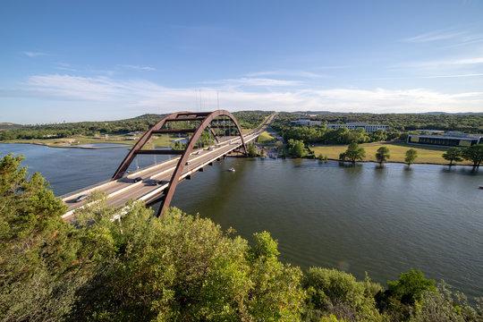 Pennybacker Bridge with downtown Austin, Texas skyline in the far distance.