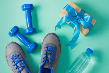 Sport flat lay composition dumbbells shoes bottle of water