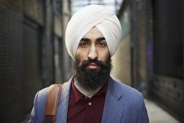 Portrait of bearded man wearing turban