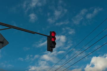 Red traffic light with timer. Against the sky. Countdown Traffic Light.