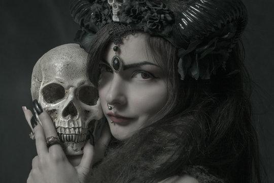 Horned asian girl with skull