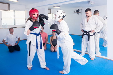 Trainees receive a punch technique in sparring