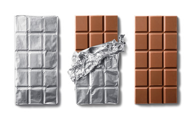 Top view of milk chocolate bar and chocolate bars in foil. Isolated on white background